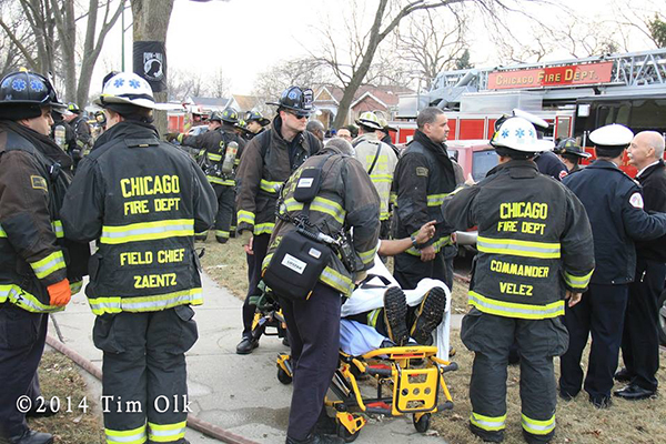 injured fireman on stretcher
