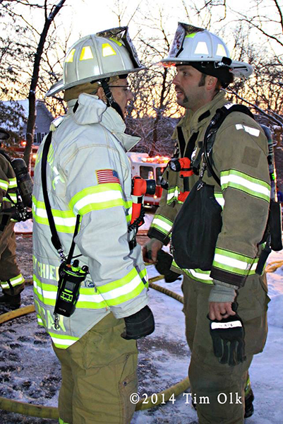 chief fire officers confer at fire scene