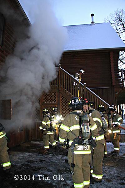 firemen cut residential garage door to attack a fire
