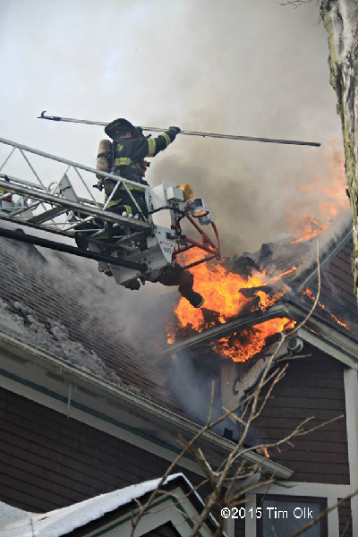 fireman on ladder tip with fire