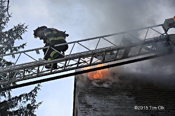 fireman climmbing aerial ladder