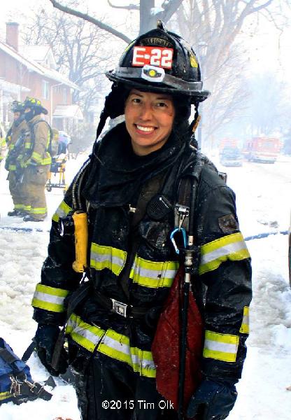 female firefighter at winter fire scene