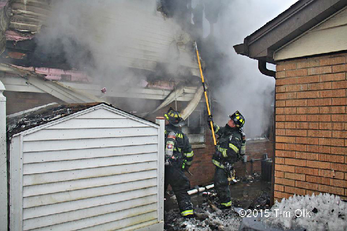 firemen overhaul at house fire