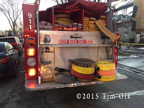 fire engine with hose on the back step