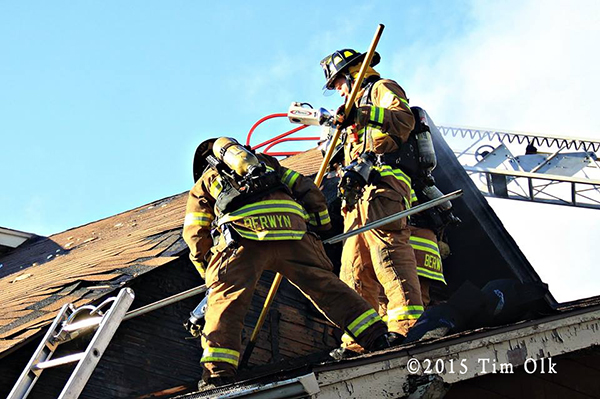 firemen on roof doing overhaul