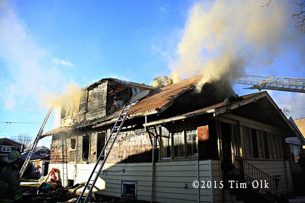 house fire with brown smoke