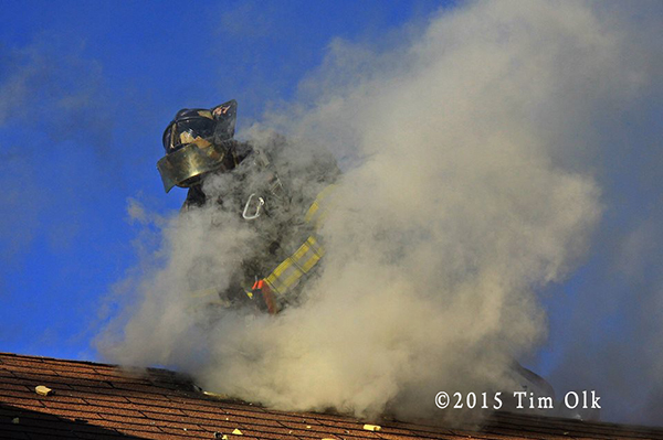 fireman on roof in smoke