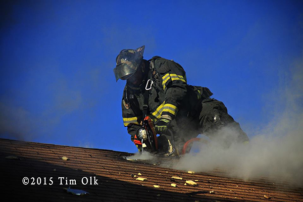 fireman cuts roof with saw