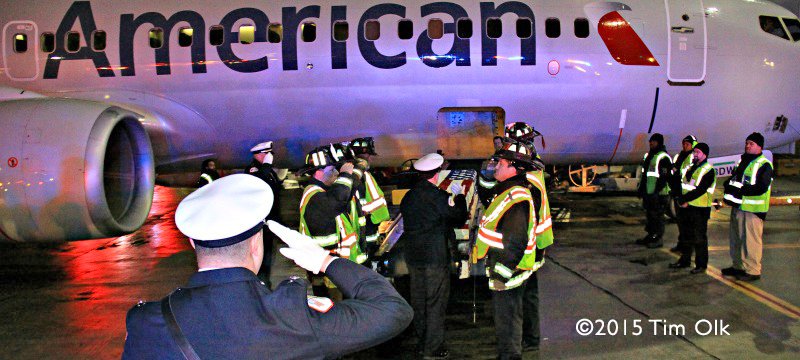 firefighters escort casket from airplane