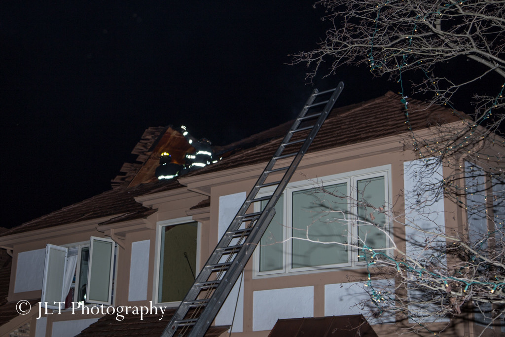 ladder to roof of house at night