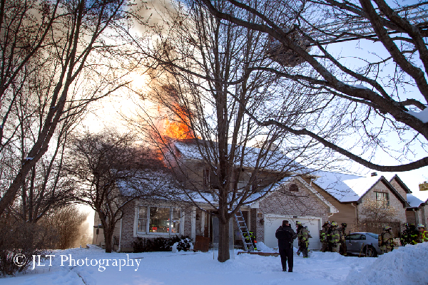 house fire with flames through roof