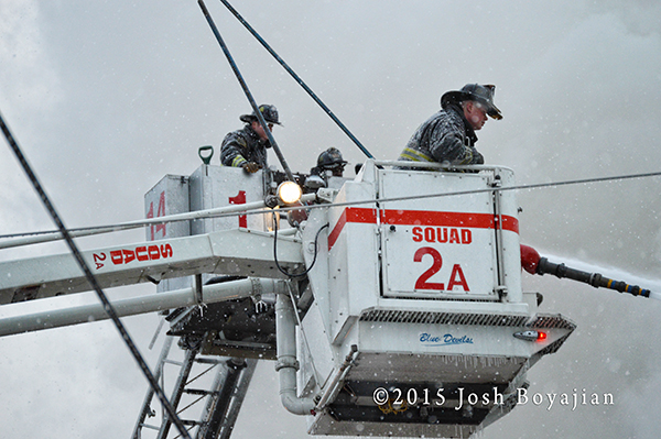 Chicago firemen in Snorkel and tower ladder
