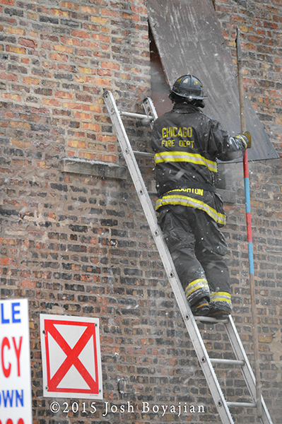 fireman on ladder with pike pole