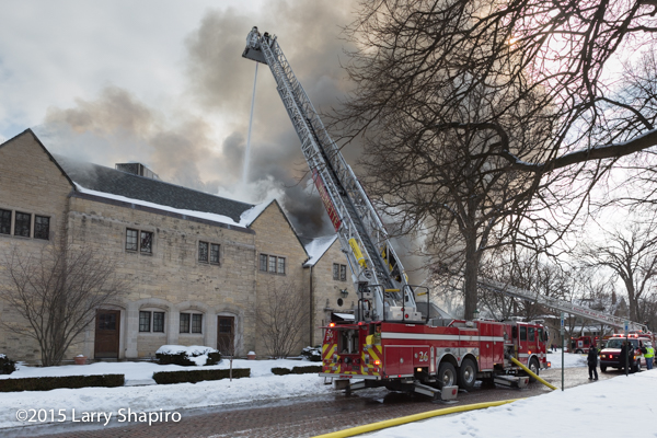 E-ONE tower ladder as big flames burning through the roof