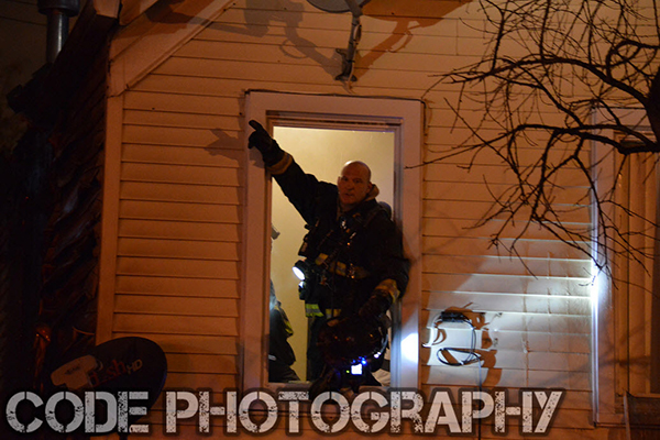 fireman at house window after fire