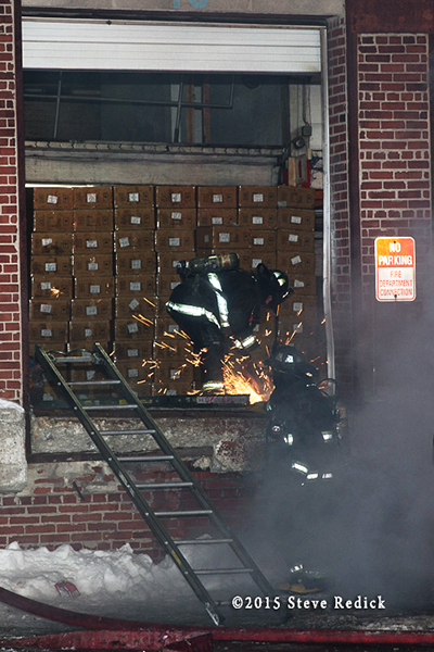 firemen work at a night winter fire scene in a commercial building