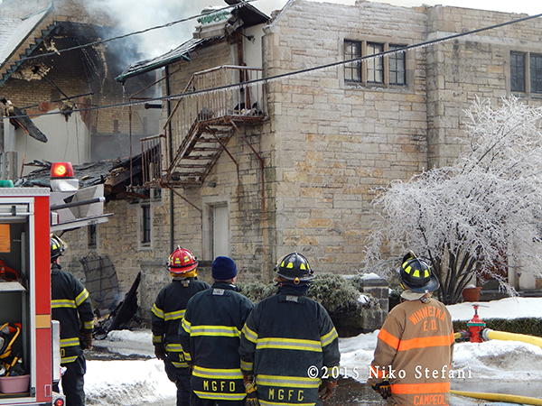 firemen at winter fire scene