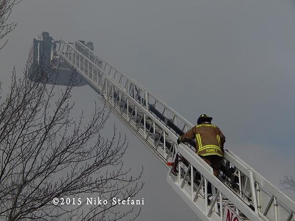 fireman climbing aerial ladder