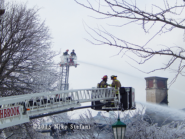 fire trucks at winter fire scene