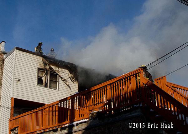 firemen overhaul roof after fire