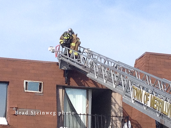 fireman on aerial ladder