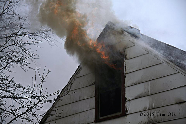 flames from attic of house on fire