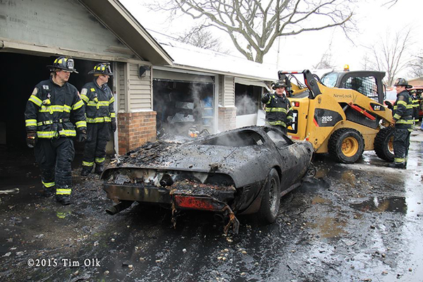 firemen overhaul after a garage fire
