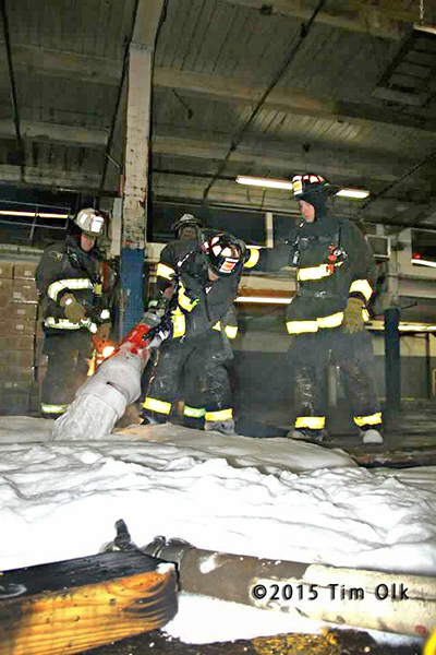 firemen use high expansion foam at night