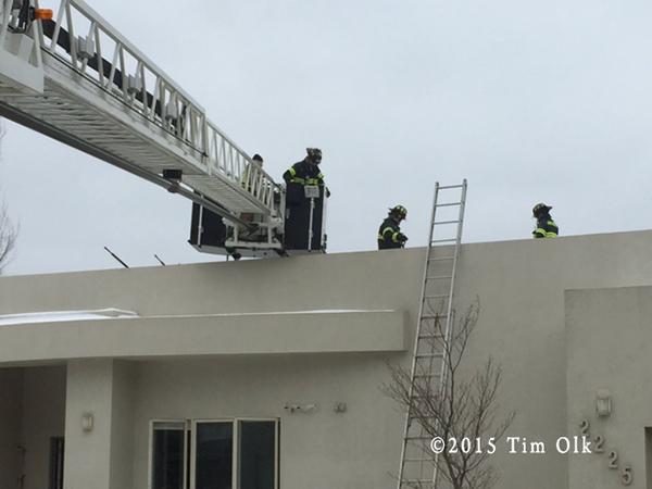 firemen at house fire scene