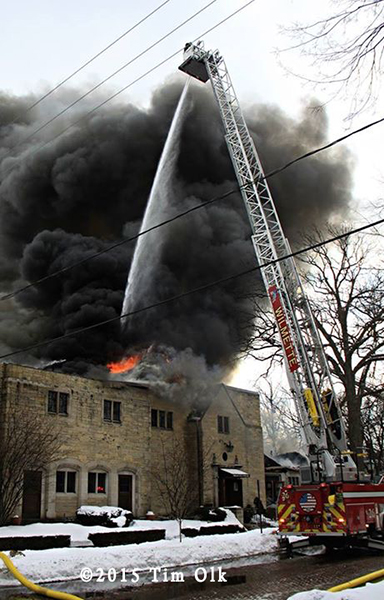 E-ONE tower ladder working at huge fire