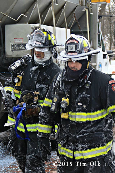 firemen covered with ice