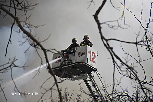 Peirce tower ladder at smokey fire scene