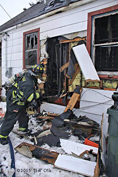 firemen overhaul house fire