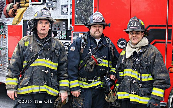 firemen pose after fighting a fire