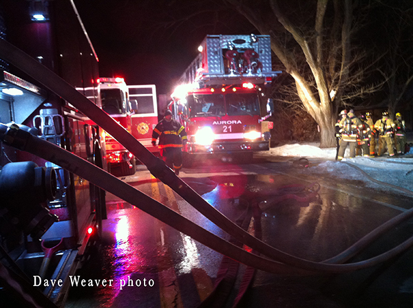 fire trucks at night house fire scene