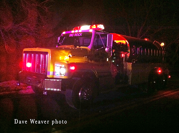 fire truck at night house fire scene