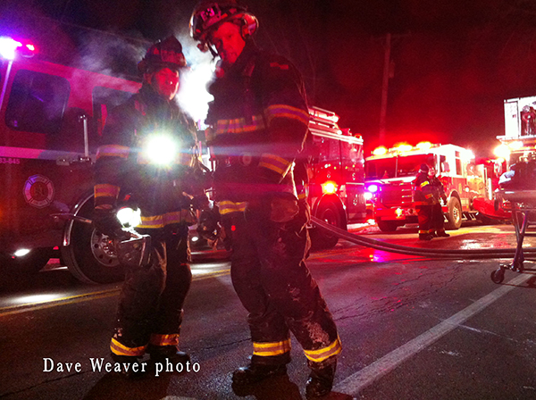 firemen at night house fire scene
