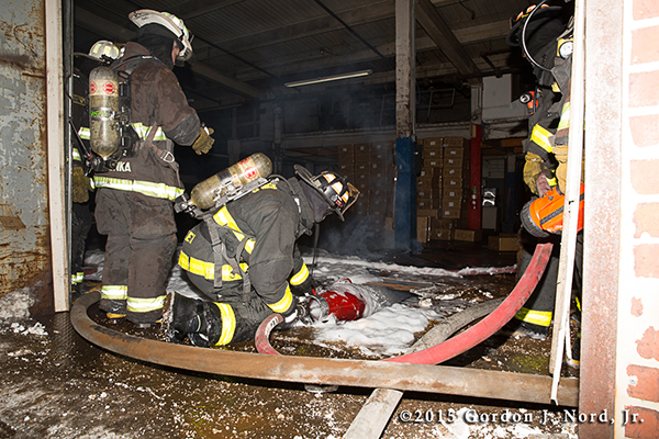 Chicago firemen applying high expansion foam