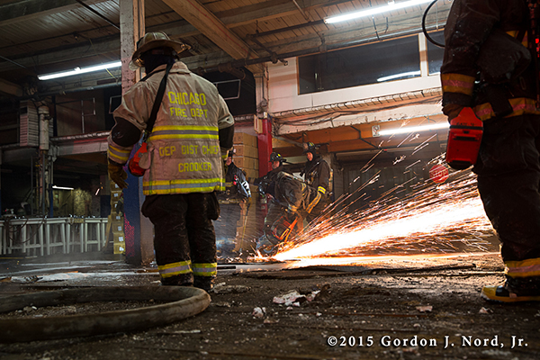 fireman just floor with saw and sparks at night
