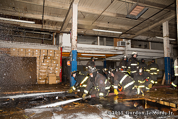 firemen battle commercial basement fire