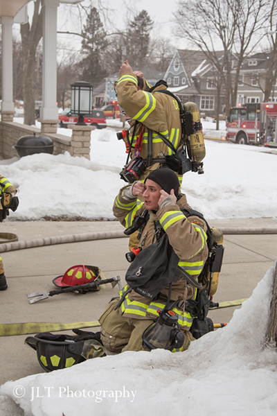 firemen putting on PPE to enter a house