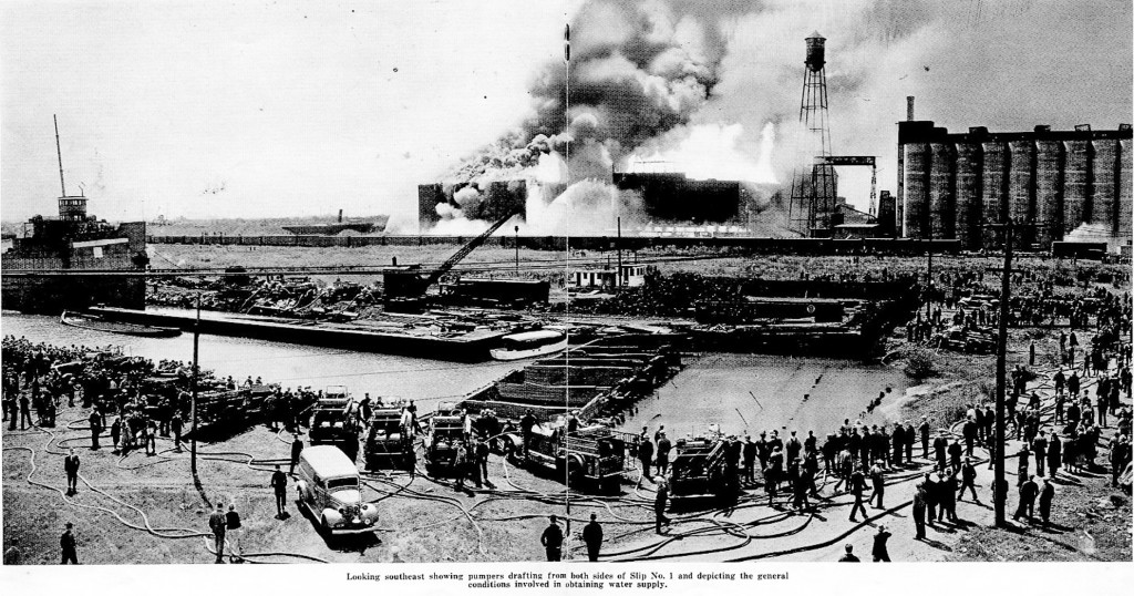 historic photo showing Chicago FD Ahrens Fox pumpers at a huge fire