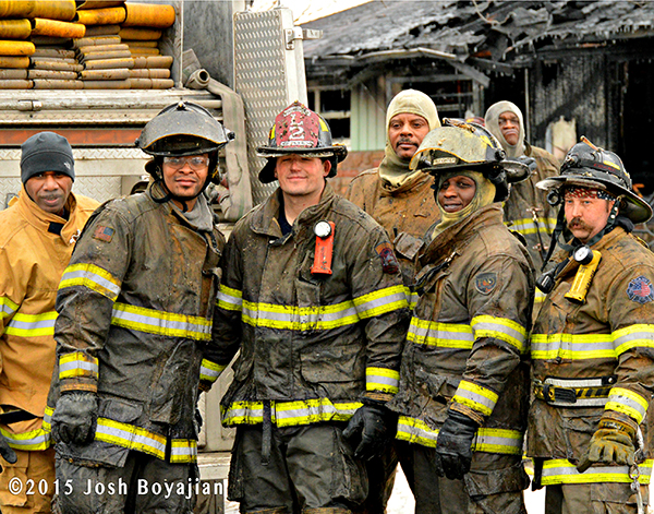 group of firemen after battling a fire