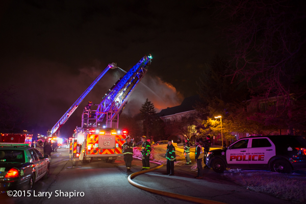 LED lights illuminate fire truck aerial ladder at night