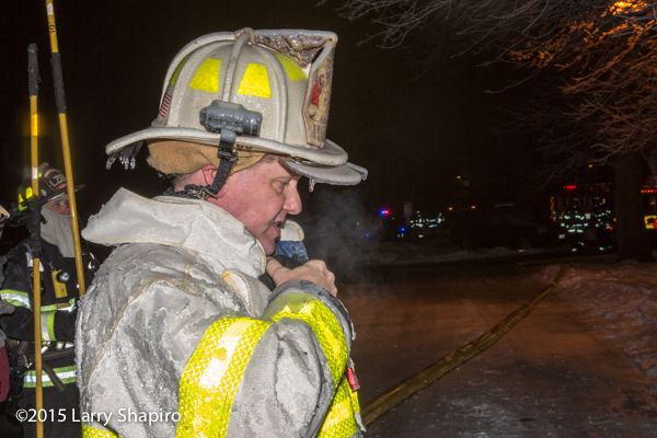 fire chief Pete Ahlman covered with ice at winter fire scene