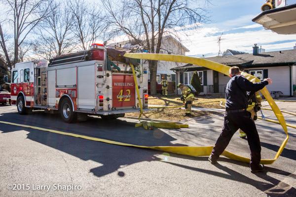fireman pulls large diameter (LDH) hoe off an engine