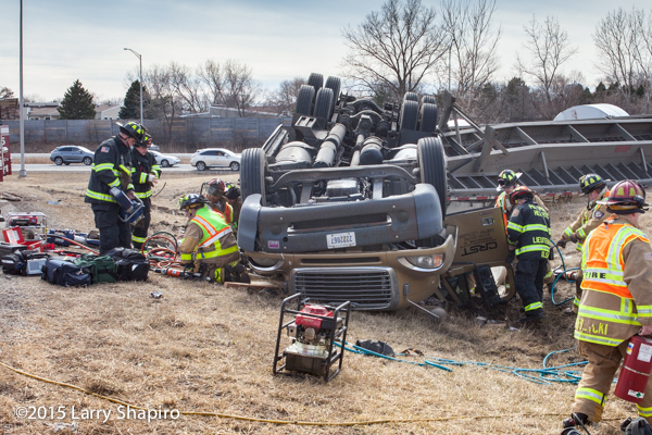 firemen rescue victims from rolled over semi tractor