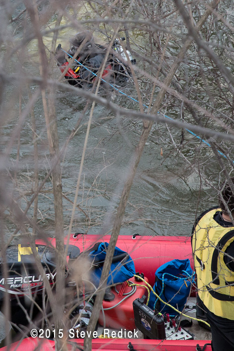 fire department divers working in a river