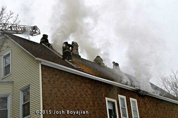 firemen venting a peaked roof