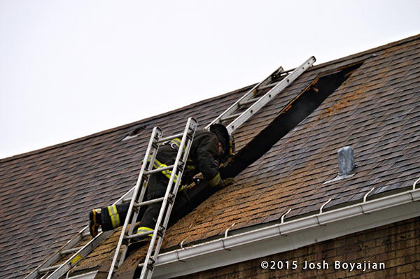 fireman on peaked roof after ventilating